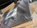 Livre photo emballé dans un film plastique de protection